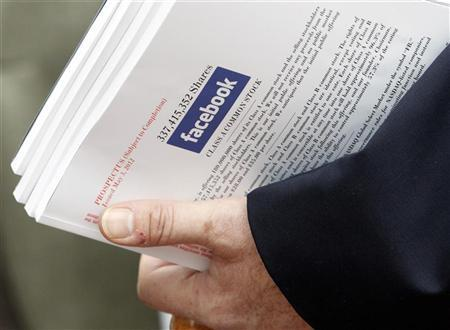 Investor holds prospectus explaining Facebook stock after attending show for Facebook Inc's initial public offering at the Four Season's Hotel in Boston