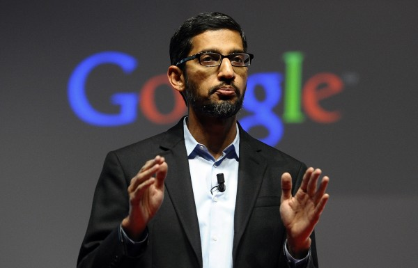 "FILE - In this Monday, March 2, 2015 file photo, Sundar Pichai, senior vice president of Android, Chrome and Apps, talks during a conference during the Mobile World Congress, the world's largest mobile phone trade show in Barcelona, Spain. Google is creating a new company ""Alphabet"" to oversee its highly lucrative Internet business and a growing flock of other ventures, including some — like building self-driving cars and researching ways to prolong human life — that are known more for their ambition than for turning an immediate profit. Google CEO and co-founder Larry Page will be CEO of the new holding company, while longtime Google executive Sundar Pichai will become CEO of Google's core business, including its search engine, online advertising operation and YouTube video service. (AP Photo/Manu Fernandez, File)"