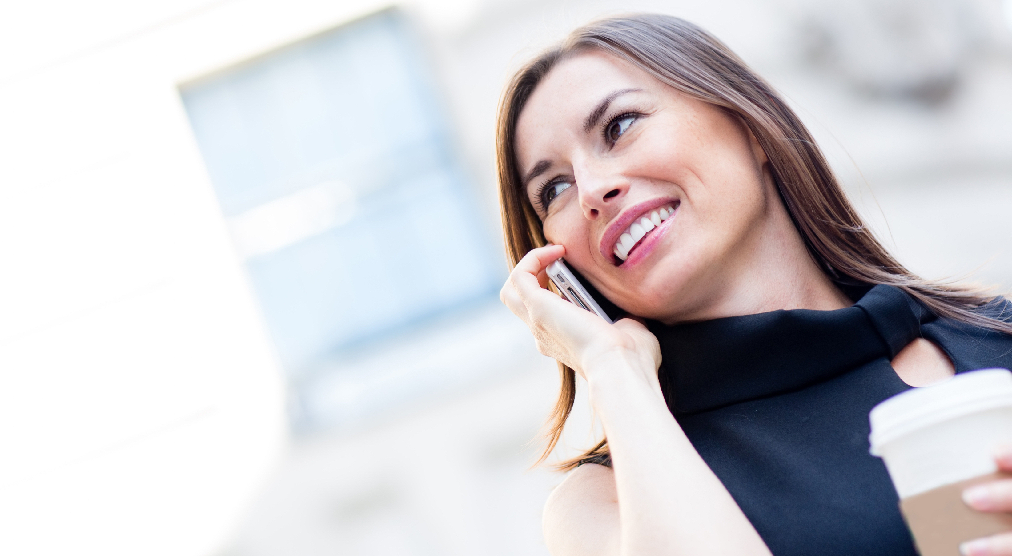 Happy businesswoman talking on the phone outdoors