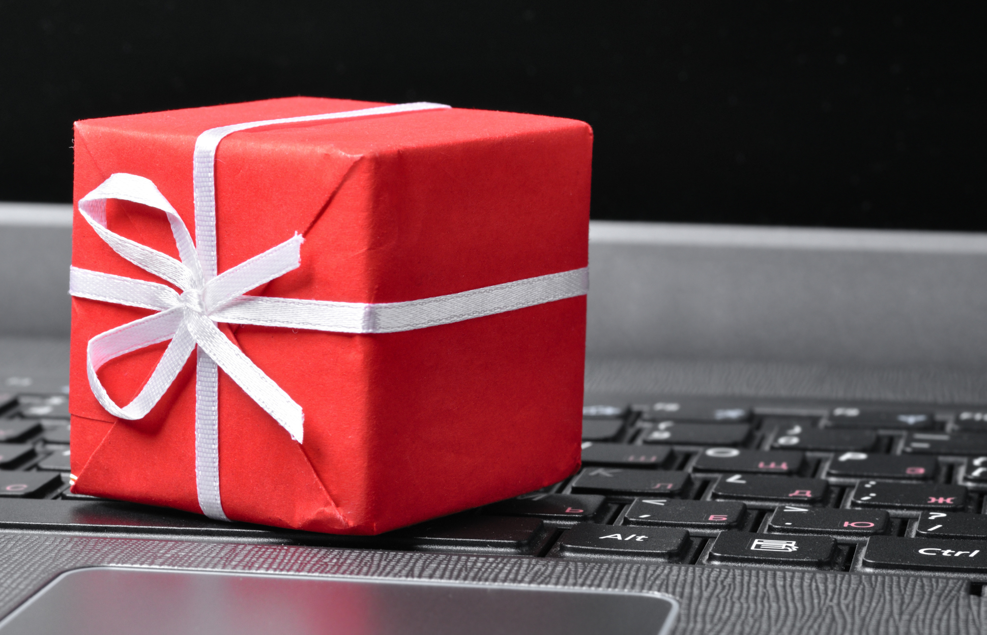 red gift box on a laptop keyboard