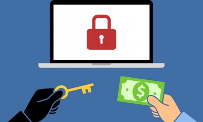 55731612 - locked computer ransomware with hands holding money and key flat vector illustration