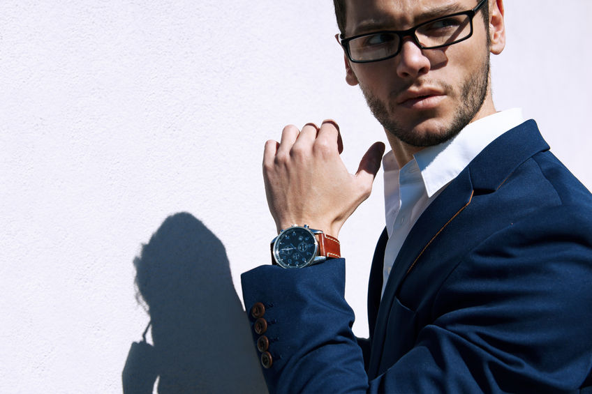 45177472 - young handsome man wearing fashion eyeglasses against neutral background with lots of copy space