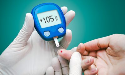 Doctor making blood sugar test.