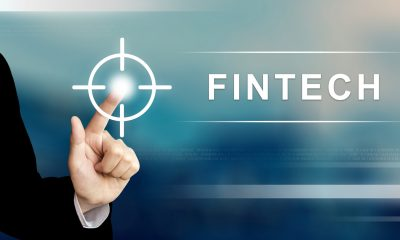 business hand pushing fintech or financial technology button on a touch screen interface