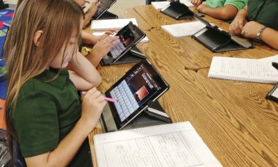 Students at Coachella Valley Unified School District use iPads during a lesson. The district's superintendent is promoting the tablet initiative as a way to individualize learning.