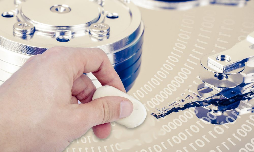 17427680 - an image of hand with eraser removing data from hdd