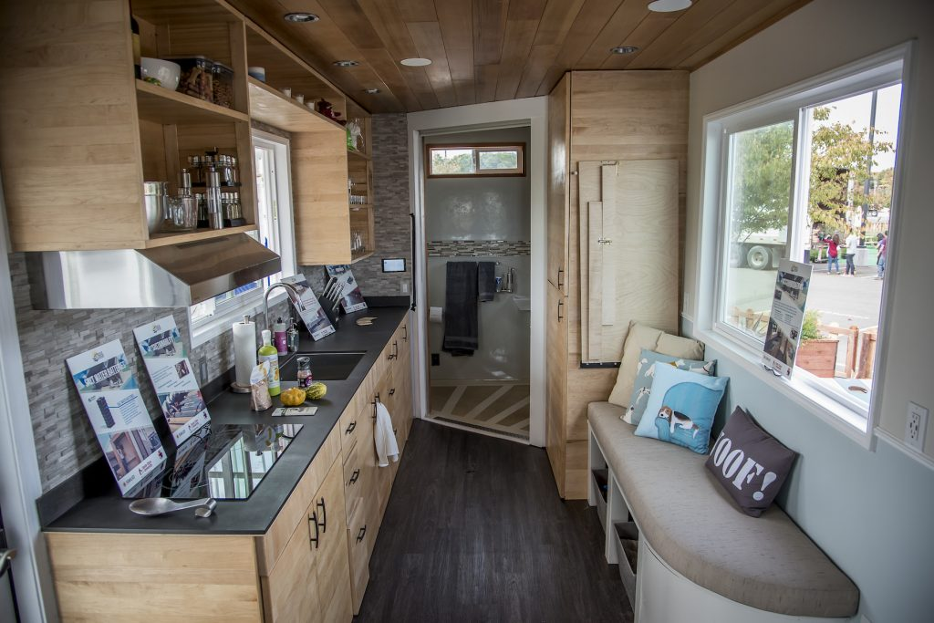 Images of the interior of Santa Clara University's rEvolve House during the 2016 Tiny House Competition in Sacramento on October 13, 2016. When the contest is over, the 238-square-foot solar-powered home will go to Operation Freedom Paws (OFP), a 501(c)3 nonprofit organization empowering military veterans and others with disabilities to restore their independence by teaming them up with a service dog. Sacramento Municipal Utility District (SMUD) is hosting a Tiny House Competition modeled after the Solar Decathlon created by the U.S. Department of Energy. The purpose of the competition is to explore renewable energy, green building techniques and sustainable living while constructing net-zero energy houses. (Photo credit: Joanne H. Lee/Santa Clara University)