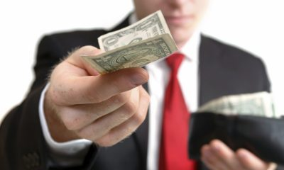 businessman_handing_a_dollar_4372659medium