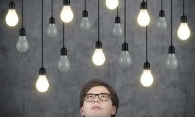 businessman thinking and looking to light bulbs
