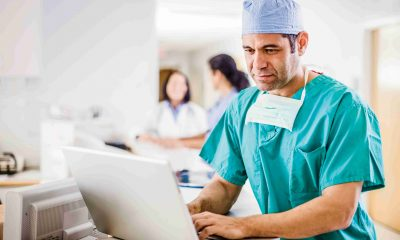 Doctor Using Laptop --- Image by © Tim Pannell/Corbis