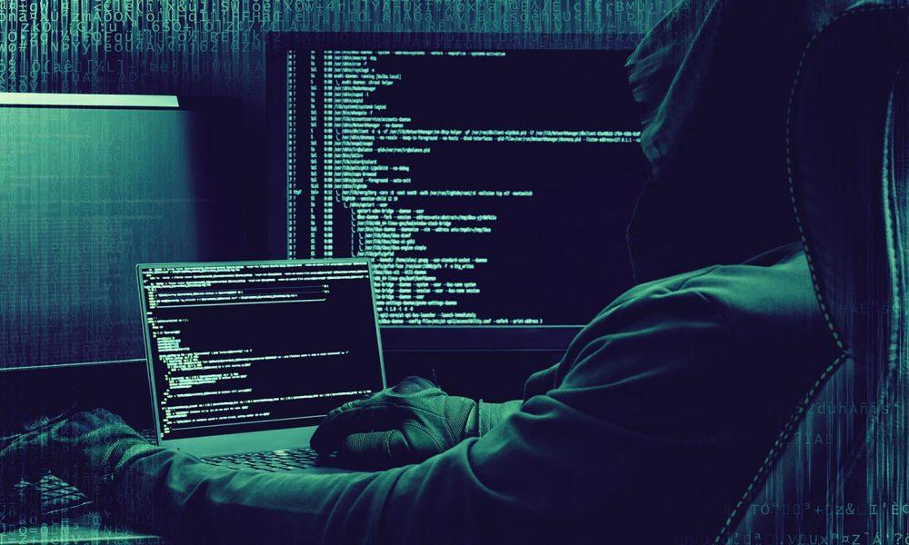 Internet concept. Hacker working on a code on dark digital background with digital interface around.