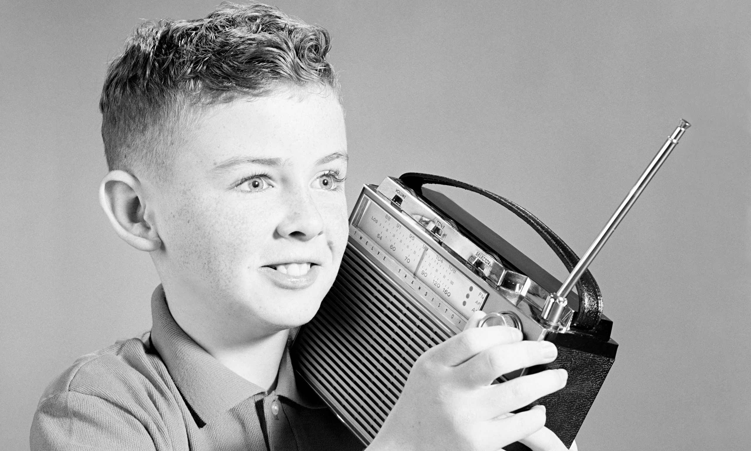 Boy listening to portable radio