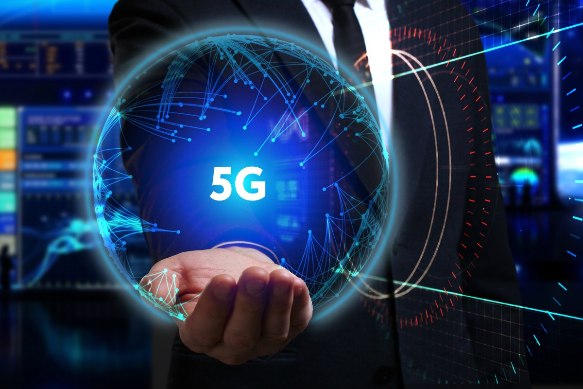 Business, Technology, Internet and network concept. Young businessman working in the field of the future, he sees the inscription: 5G