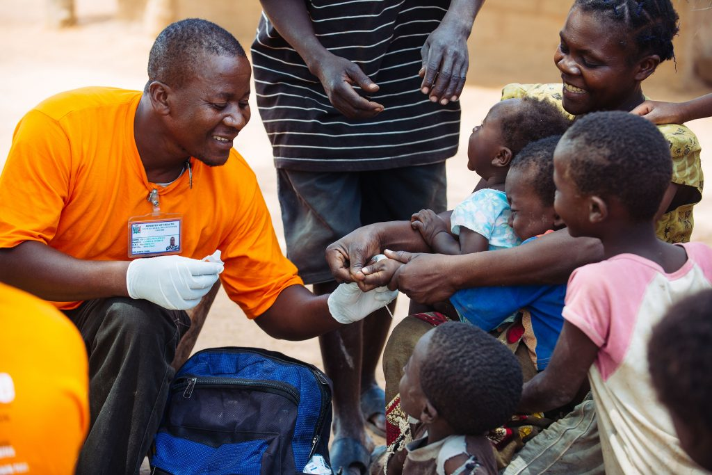 In Sinafala village, a health worker tests a child for malaria using a rapid diagnostic test.