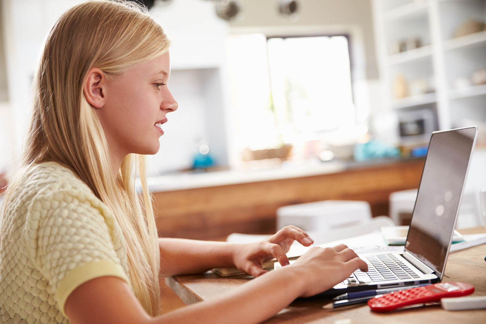 Girl using laptop computer at home