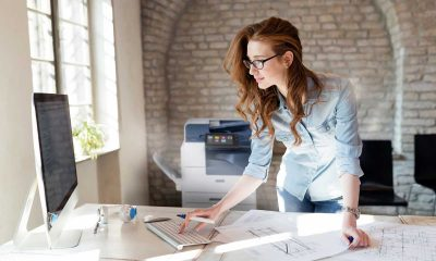 Beautiful woman working in modern office; Shutterstock ID 1039934668; Purchase Order: -