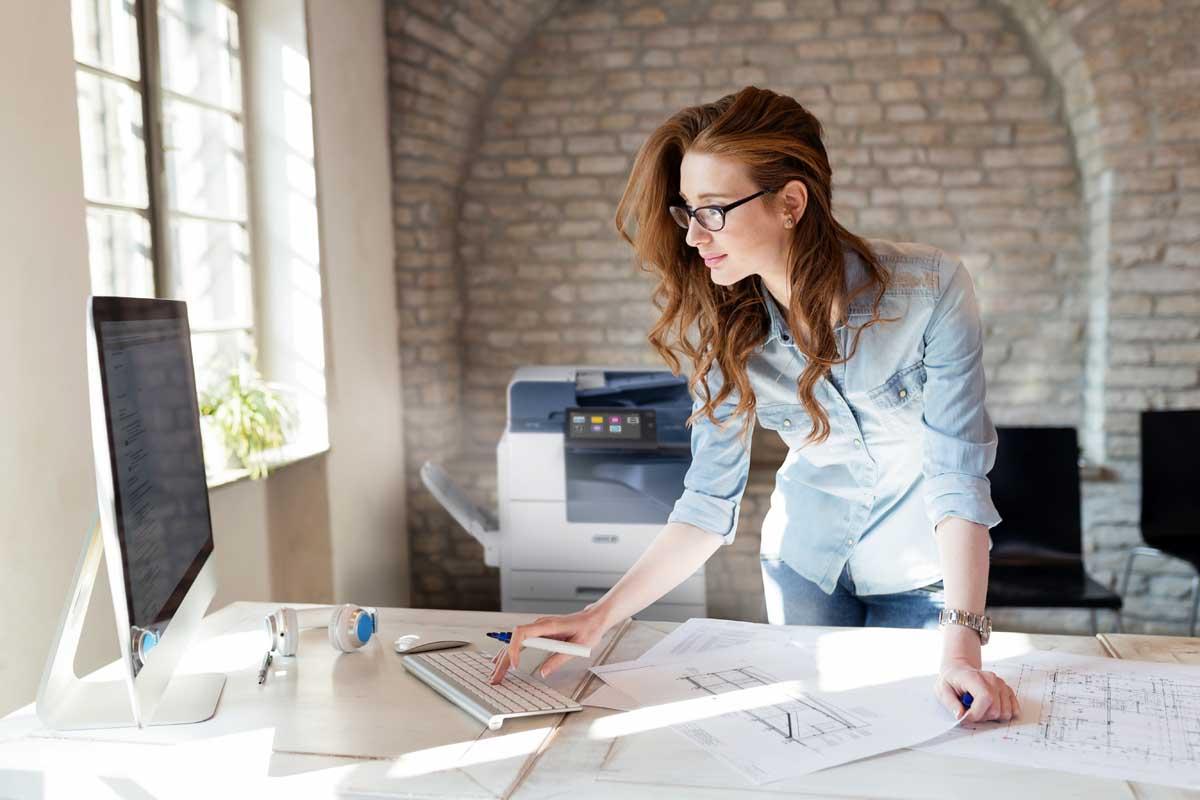 Beautiful woman working in modern office; Shutterstock ID 1039934668; Purchase Order: -