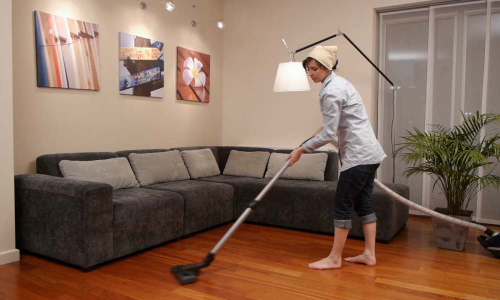 young-cleaning-lady-vacuum-cleaning-a-sitting-room_4jorblygx__f0006