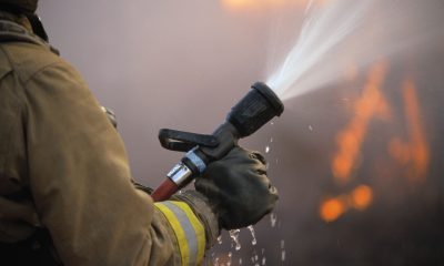 12 Feb 2002 --- Spraying Fire Hose --- Image by © Royalty-Free/Corbis