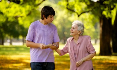 young-man-elderly-woman-visiting-1080937-print